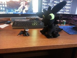 Crocheted Toothless and Tiny Sculpey Toothless