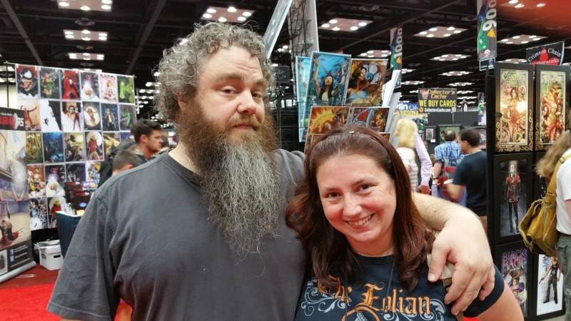 A photo of Patrick Rothfuss and I, taken in the dealers hall at Gen Con 2015.