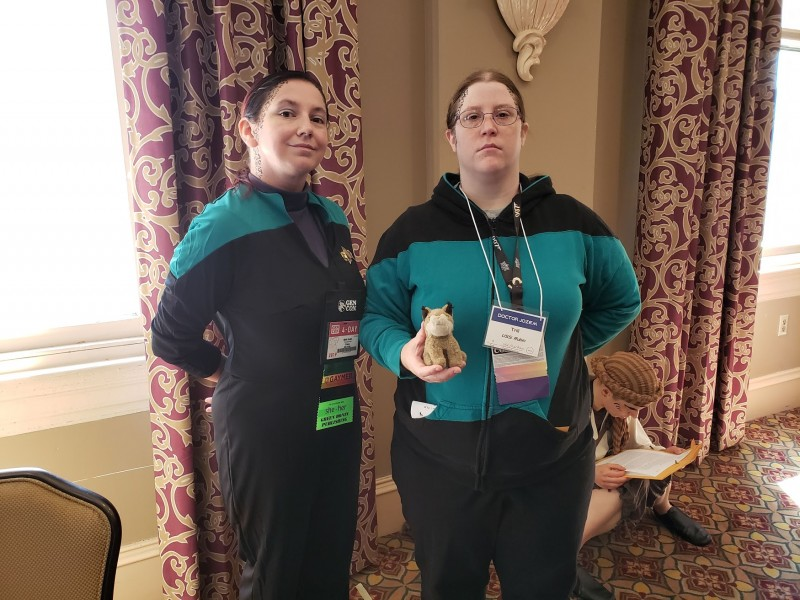 My friend Kasi and I, both wearing Starfleet science officer uniforms, with trill spot makeup on.