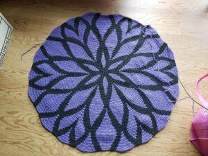 Purple and black Rozeta blanket in progress.
