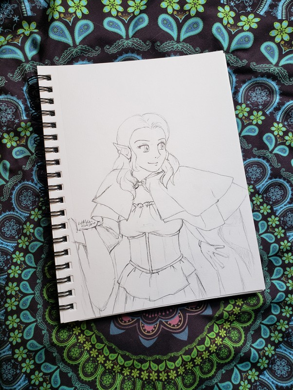 Photo of a sketchbook, open to a pencil sketch of Ëlinyr.
