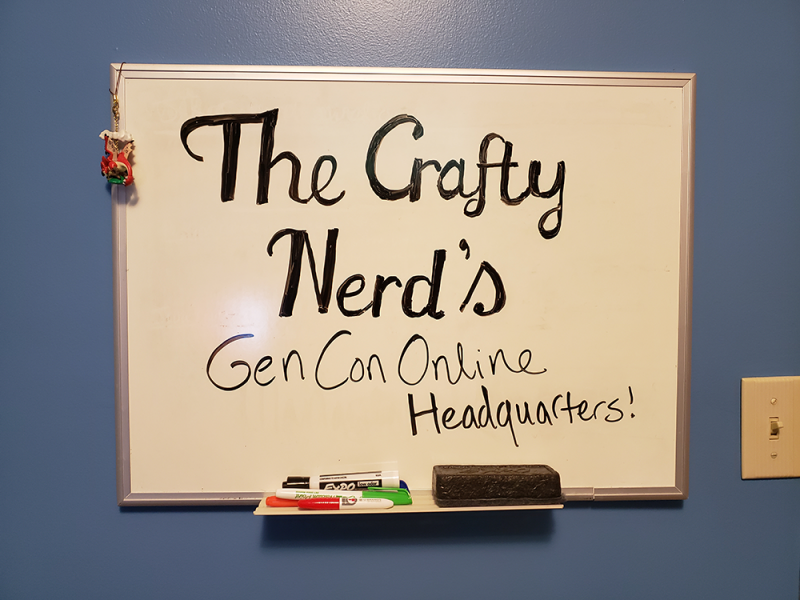 Whiteboard with the text 'The Crafty Nerd's Gen Con Headquarters!' written on it.